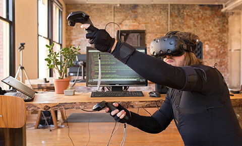 Using a virtual reality HMD and handheld controllers with full-body motion capture